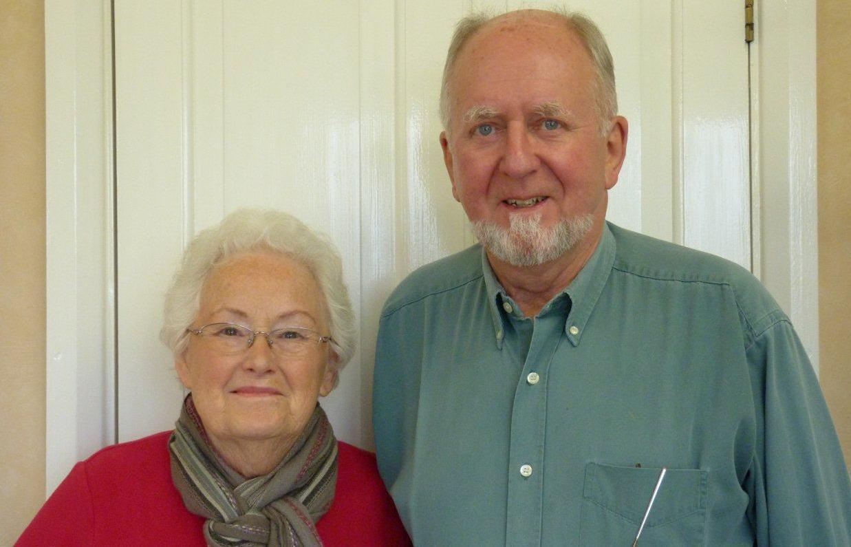 Photo of volunteers Paul & Angela smiling, a head and shoulders portrait.