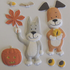 A painted tactile picture of Kipper the dog alongside a grey dog surrounded by autumn items including a pumpkin, leaf, acorn and chestnut.