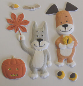 Tactile picture showing Kipper and his dog friend, and a collection autumnal things including leaves and a pumpkin.