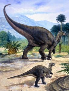 Iguanodon with baby walking through tree lined landscape.