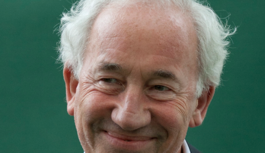 Simon Callow, close up head shot of a man with white hair, smiling.