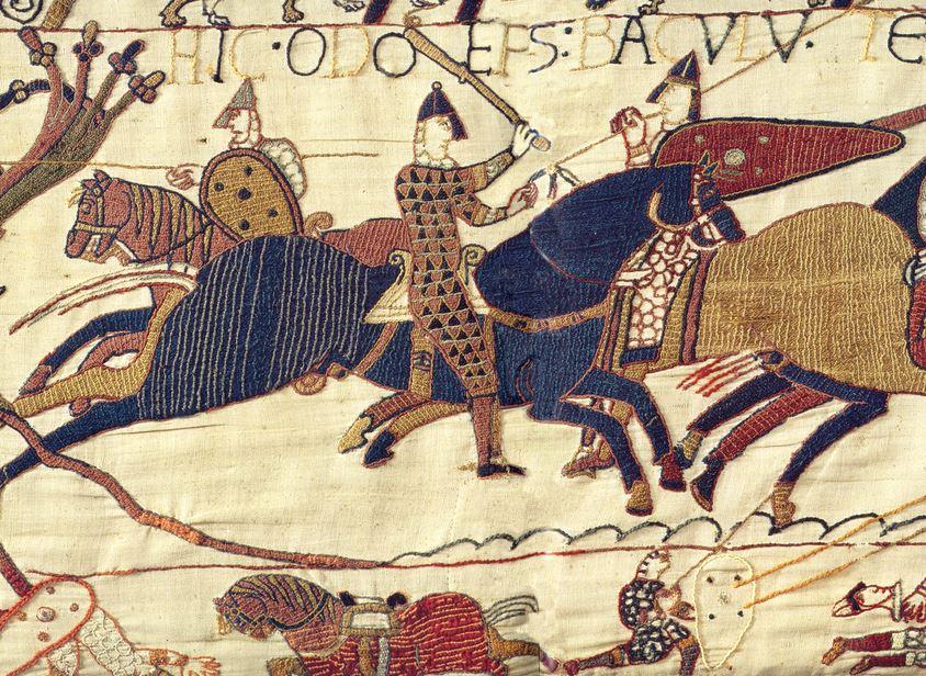 Bayeux Tapestry scene showing men on horseback.