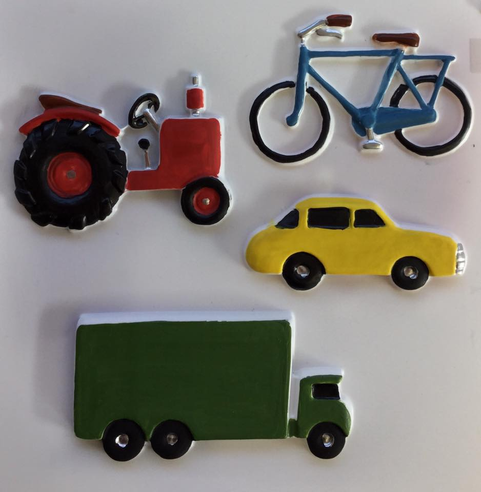 A feely picutre showing a tractor, bicycle, car and lorry.