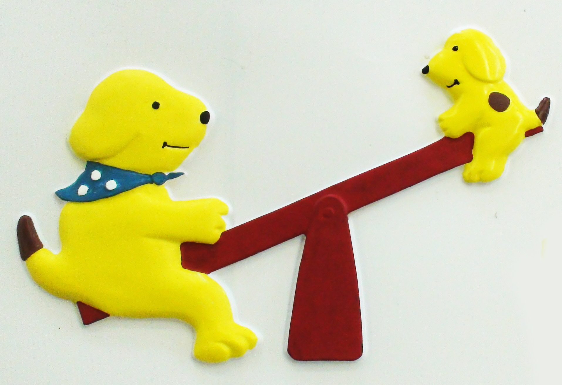 Spot and Sam on a seesaw.