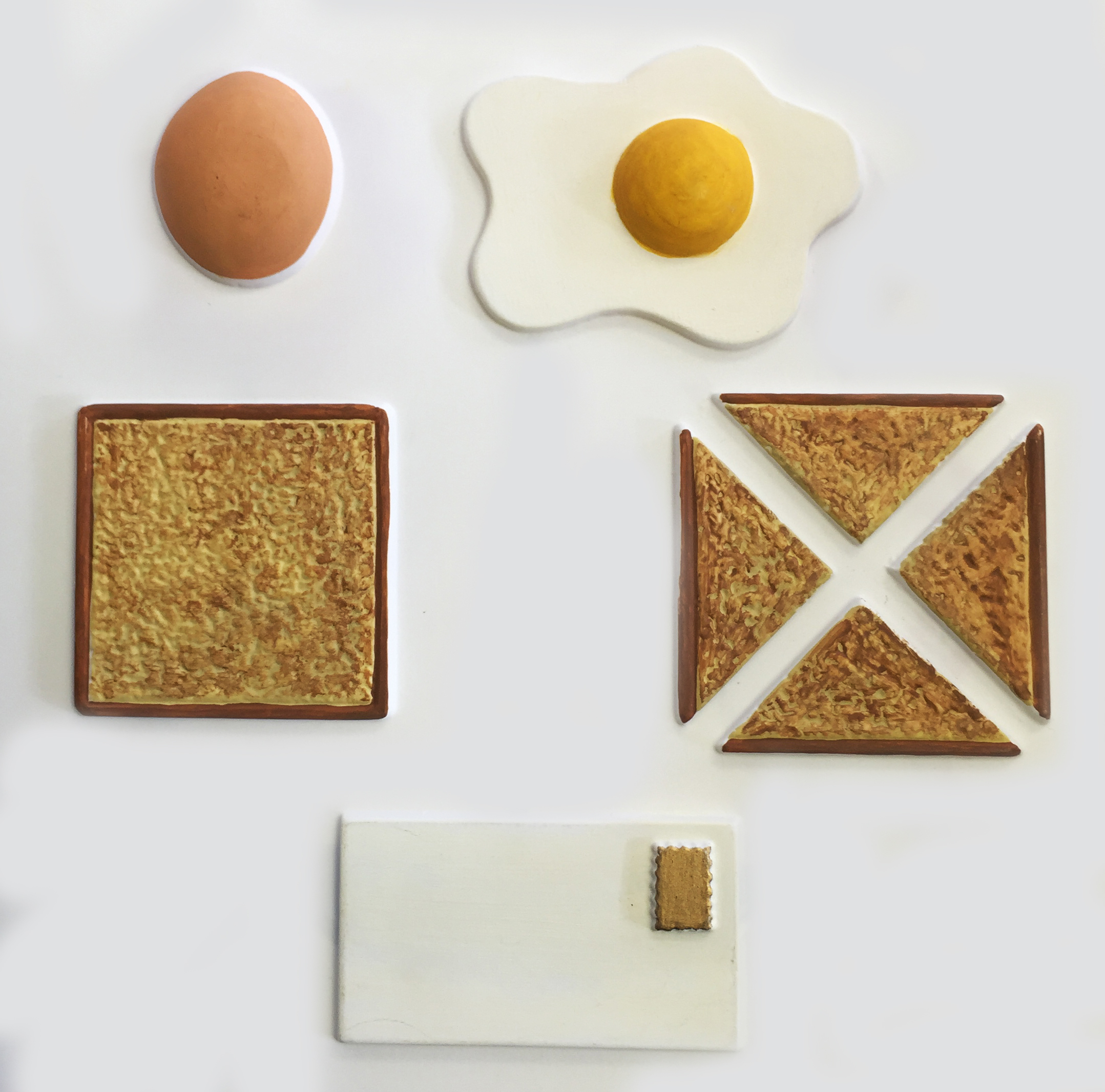 Spots breakfast tactile picture, egg and toast with an envelope with stamp.