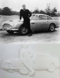 Bond car tactile image and black and white photograph showing James Bond actor Sean Connery standing beside a Austin Martin.