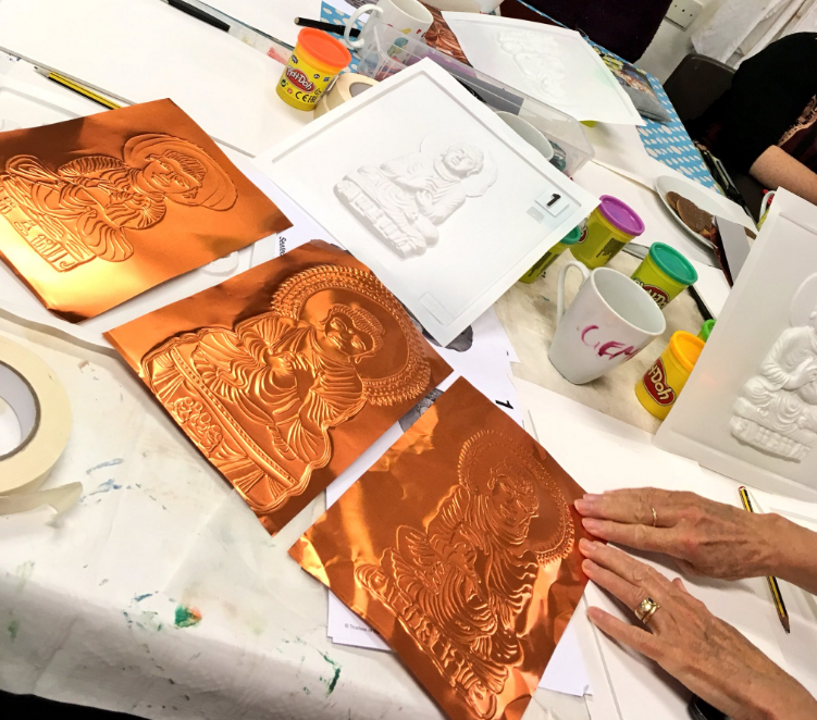 Bronze coloured replicas of the Buddha tactile image, as replicated buy the book club art group members.