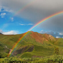 Double rainbow over a countryside landscape