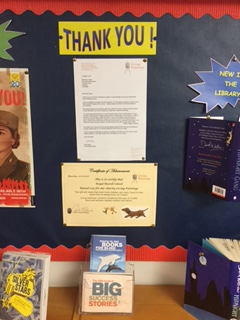 Certificate displayed on a school wall display