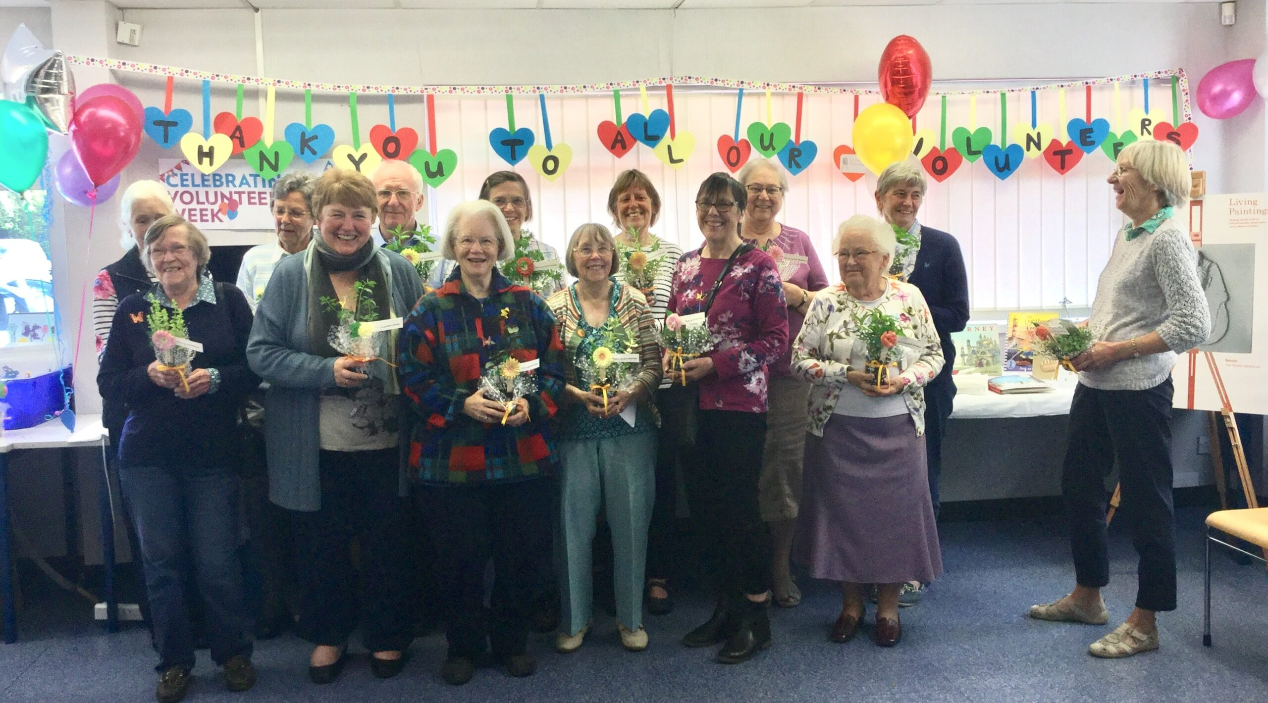 Our volunteers gathered together with plant inspired gifts