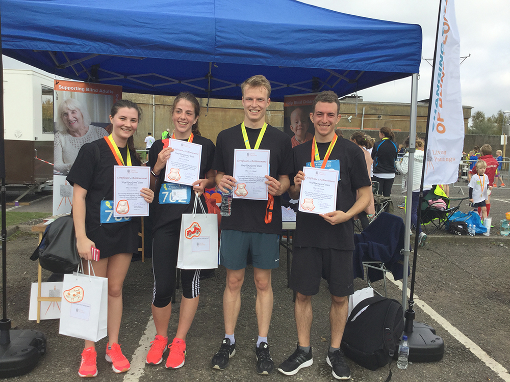 Four runners from Nationwide holding up their certificates