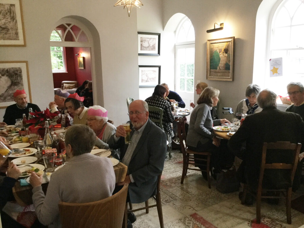Guest seated and eating a Christmas lunch.