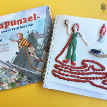 Rapunzel front cover and tactile picture, showing her with very long hair