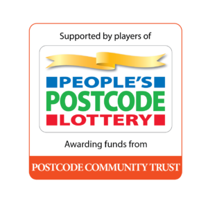 Postcode Community Trust logo, red, green and red writing with a gold sash of ribbon above.