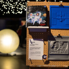 A display board showing a tactile picture of Tim Peake and the book copy of Goodnight Spaceman.