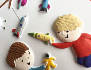 A tactile picture from Goodnight Spaceman showing two boys each holding a toy.