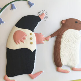 A tactile picture of a mole and a vole holding hands.