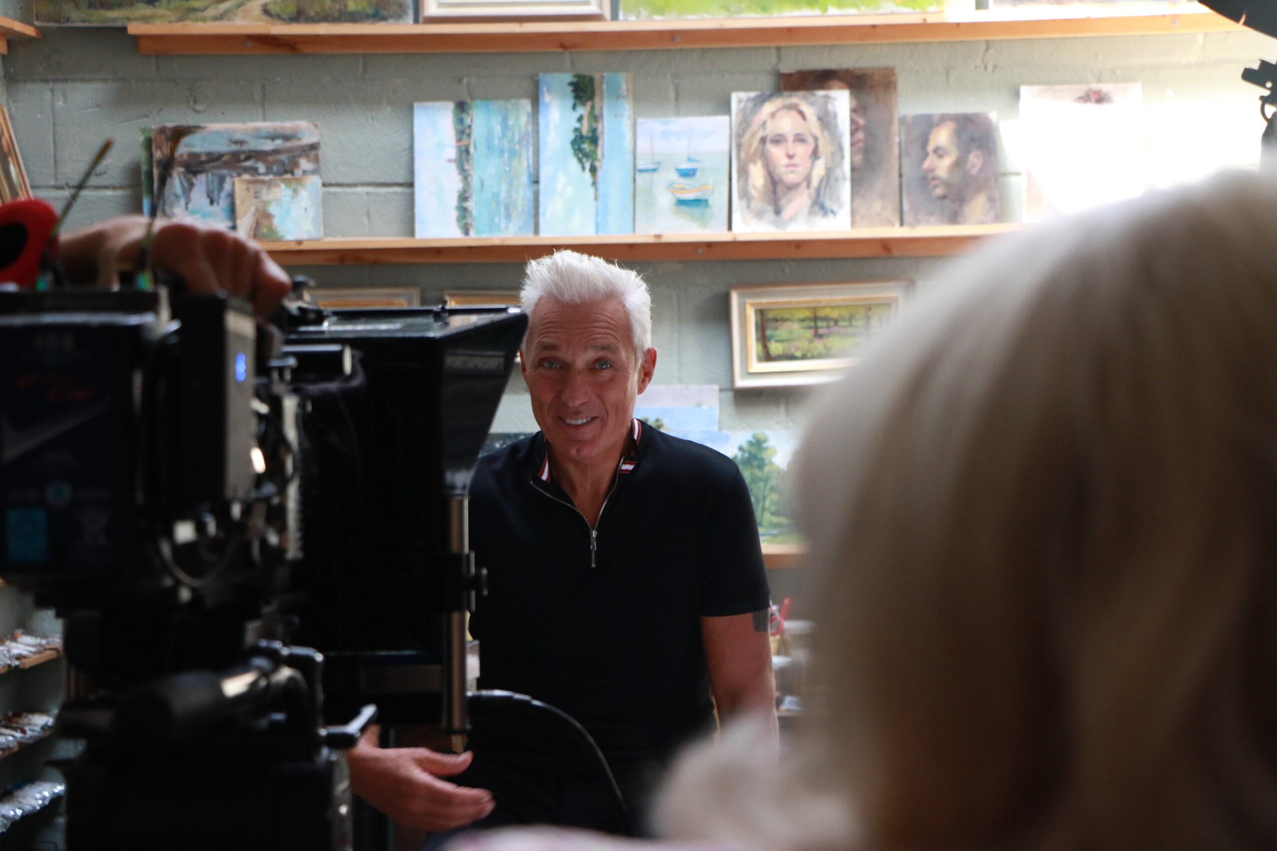 Martin Kemp being filmed in art studio, looking into the camera.