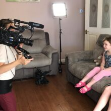 Young library member Tayen being filmed for the Lifeline appeal