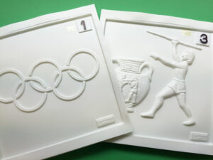 Tactile pictures of the Olympic rings and a Greek vase and athlete throwing a javelin