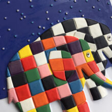 A tactile picture of Elmer and Wilbur under a starry sky