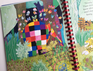 A page in Elmer's Walk featuring Elmer surrounded by colourful butterflies