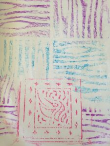 Close up of crayon rubbings of different textures and colours.