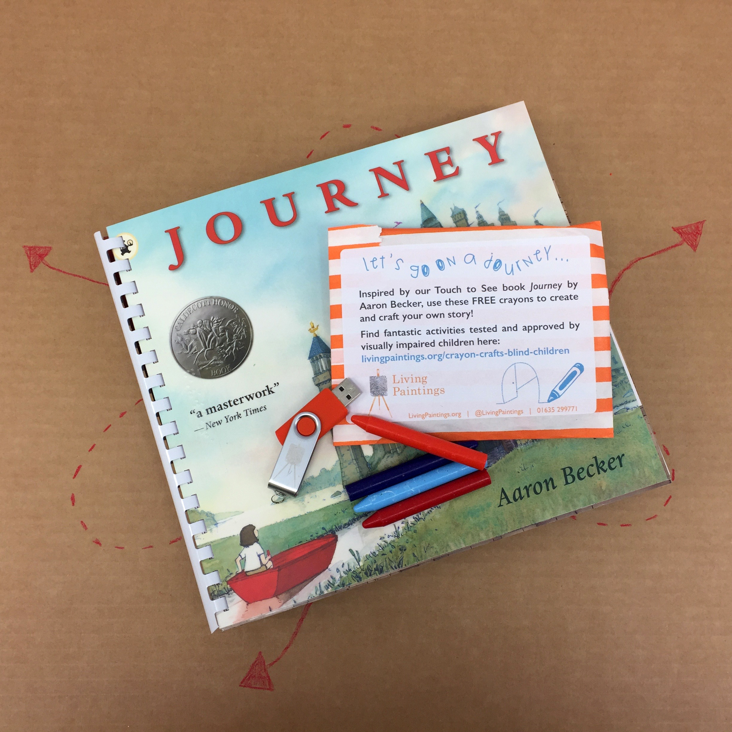 A copy of Journey with a packet of crayons and a USB
