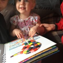 Matilda feeling a tactile picture of Elmer