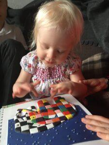 Matilda feeling a tactile image of Elmer and Wilbur