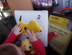 Minnie reading Fun with Spot.