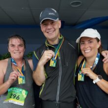 Our three runners holding up their medals