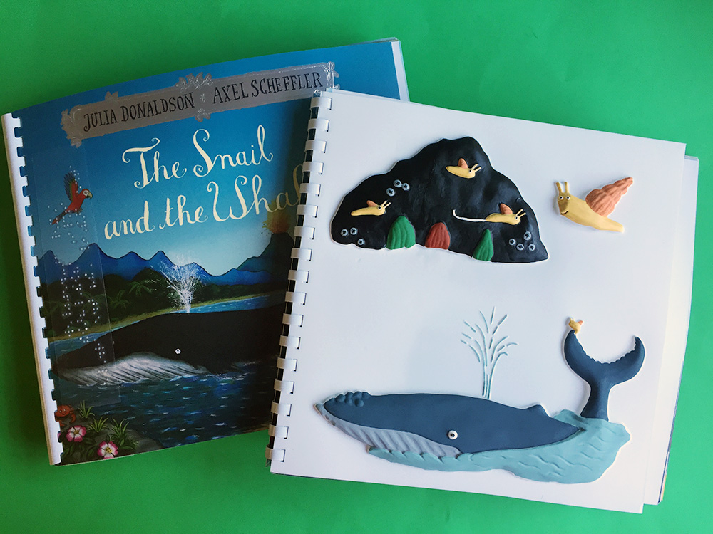 Front cover of 'The Snail and the Whale' next to a tactile picture of the whale, snail and rock.