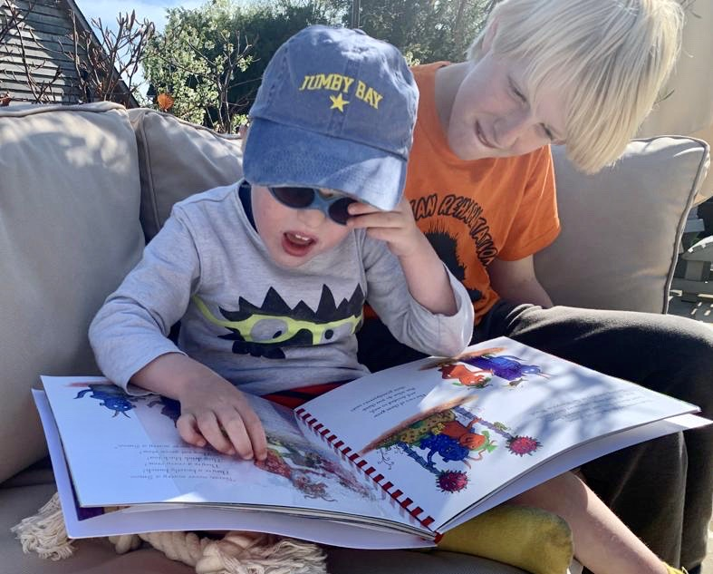 Monty, a little boy, reading The Smeds and The Smoos with his brother