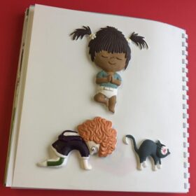 Tactile picture from Yoga Babies showing two toddleres and a cat doing yoga poses