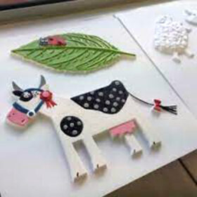 Tactile images of a cow and ladybird on a leaf