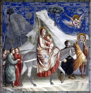 Fresco depicting Mary travelling on a donkey with baby Jesus in her arms.