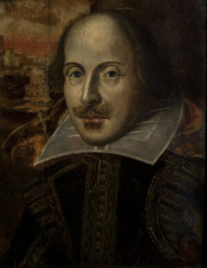 Iconic head and shoulders portrait of Shakespeare wearing white collar and embellished medieval clothing.