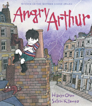 Angry Arthur written by Hiawyn Oram and illustrated by Satoshi Kitamura. A angry looking boy with arms folded  leans against a chimney stack on a roof top.