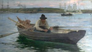 Old fisherman reeling in a catch, seated in a rowing boat in Falmouth bay.