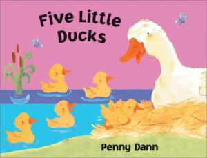 Five Little Ducks, written and illustrated by Penny Dann. A white mummy duck sitting in a nest on the bank of a lake looking at her five little ducks swimming.