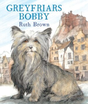 Greyfriars Bobby written and illustrated by Ruth Brown. A small, black and brown dog with a kind, sweet face sits in an old fashioned street, with Edinburgh Castle high up on a hill behind him.