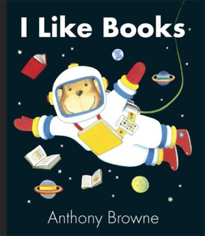 I Like Books written and illustrated by Anthny Browne. A smiing monkey, wearing an astonaut suit and helmet, floats in space surrounded by planets, stars and books.