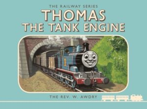 Thomas The Tank Engine and Friends by The Rev W Awdry. A smiling blue steam engine puffs out of a tunnel.