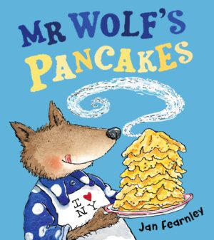 Mr Wolf's Pancakes, wirtten and illustrated by Jan Fearnley. A wolf in a spotty blue top and apron licks is lips as he carries a huge pile of pancakes on a plate.