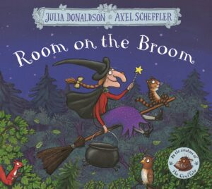 Room on a Broom, written by Julia Donaldson and illustrated by Axel Scheffler, a witch complete with pointy hat and magic wand rides on a broomstick high above a woodland, a little stripy cat sits up front.