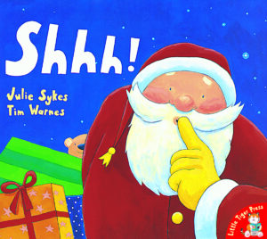 Shh!written by Julie Sykes and illustrated by Tim Warnes. Shhh Father Christmas has his finger to his mouth as he creeps around with a sack full of presents!
