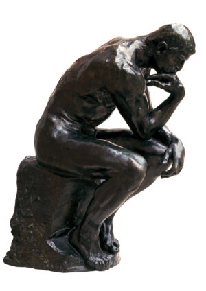 Photograph of this six foot bronze sculpture of a seated man leaning over, head resting on one hand, deep in thought.