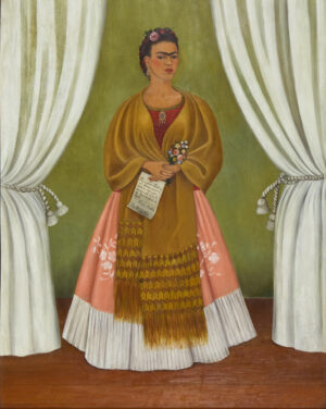 Full length self portrait of Frida Kahlo in an elaborate dress. She is perfectly poised and in her clasped hands she holds a bouquet of flowers and a letter.