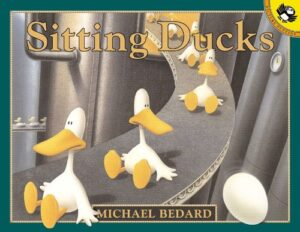 Sitting Ducks, written and illustrated by Michael Bedard. Some white newly hatched ducks are sitting in a row all looking rather bemused.